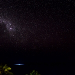 Night photos of the Underwater Room looking like a UFO that has landed on the water with the Milky Way as a roof