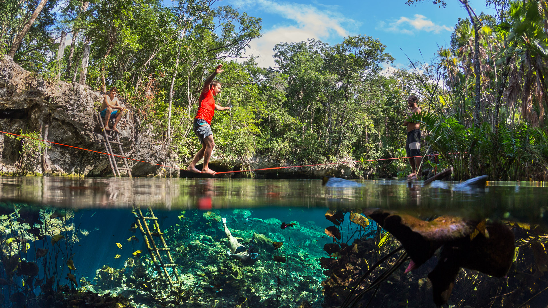 Adventure photographer – Slacklining over a cenote in the ...
