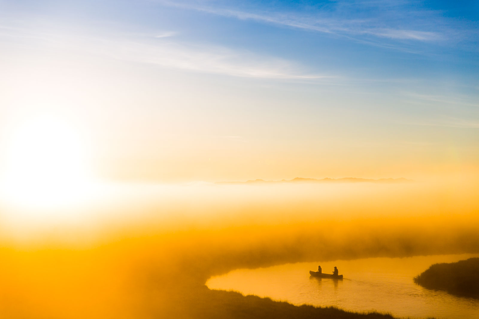 Canoeing in the morning mist. Award winning adventure photographer. Photo tips for landscapes. Montana, USA