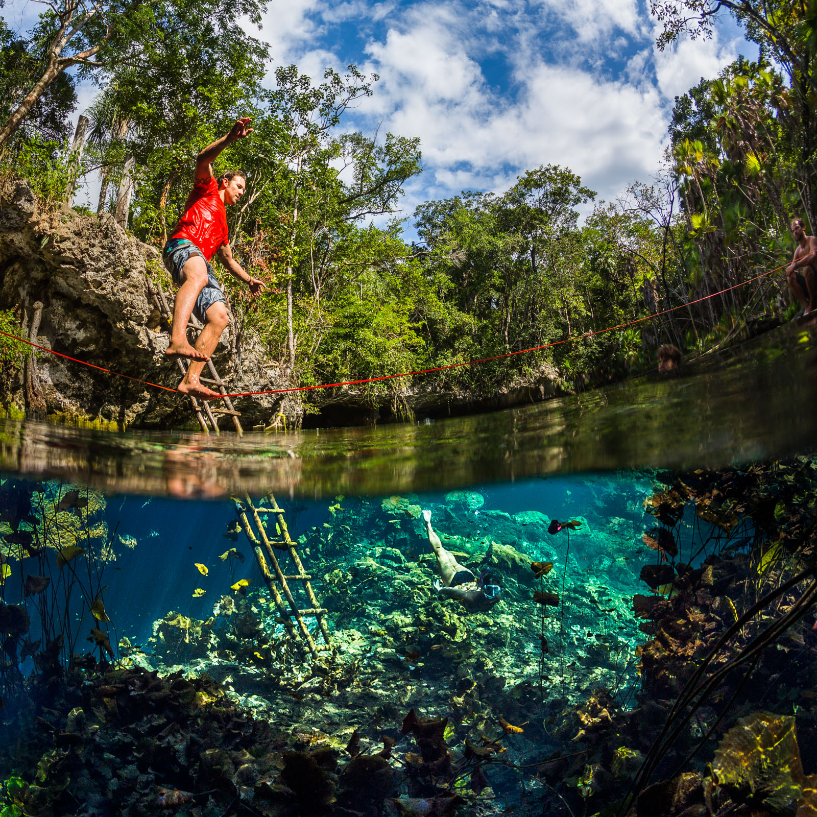 split surface award winning underwater photographer, mexico, cenote, slackline