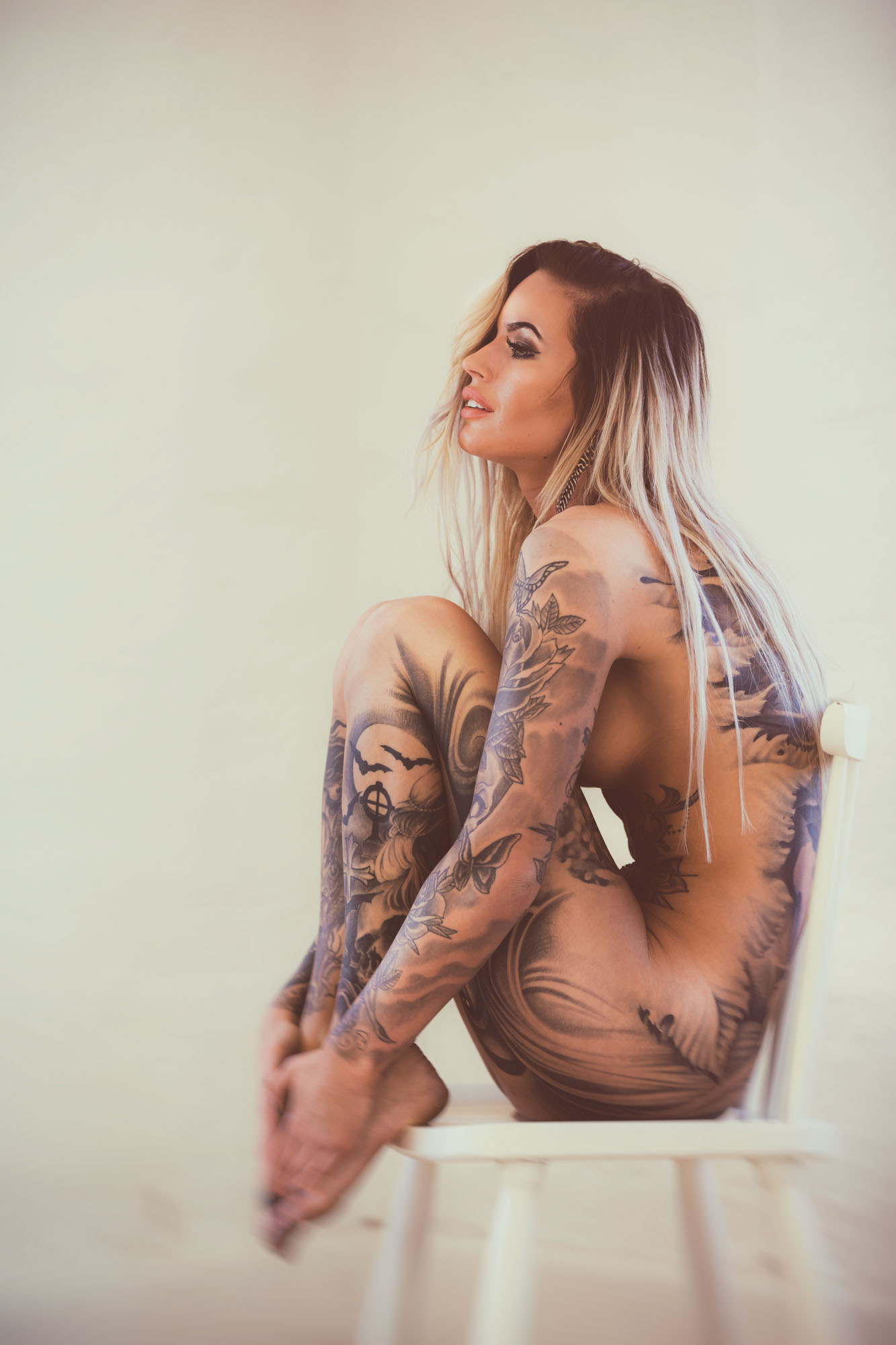Portrait photographer Jesper Anhede, nude tattoo girl on chair, Linn Forsberg, Sweden