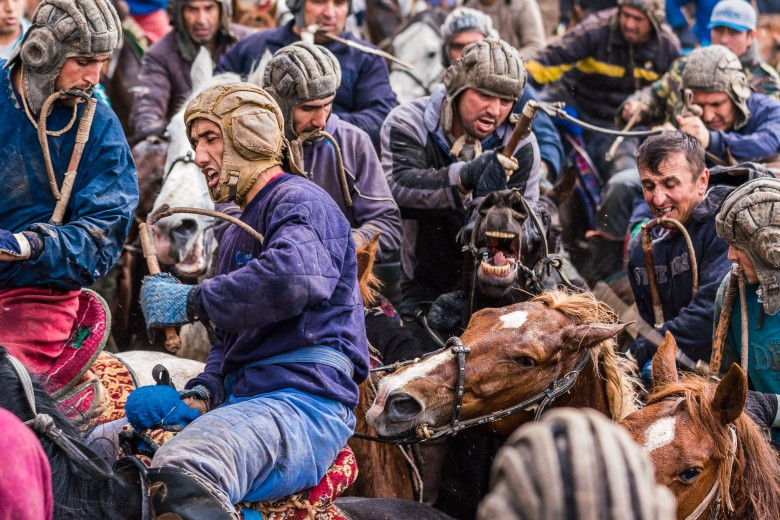 Photojournalism - Buzkashi riders in a fierce battle. Tajikistan, Central Asia