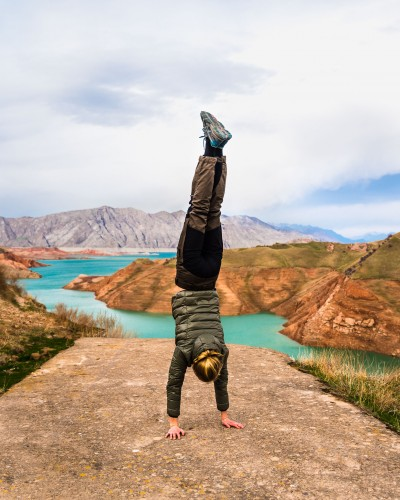 Handstand at Nurek reservoir in Tajikistan